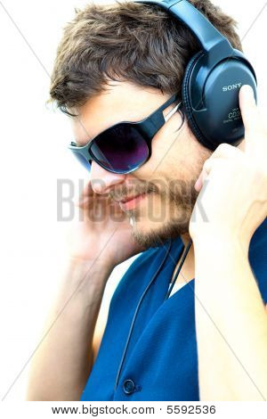 Good looking man listening to music