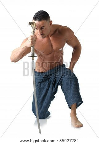 Muscular Man Kneeling On The Floor Shirtless, With Japanese Sword