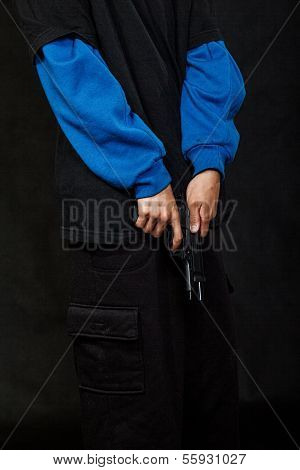 Teenage Gangster Holding Gun