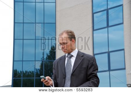Businessman With Cellphone In Hand