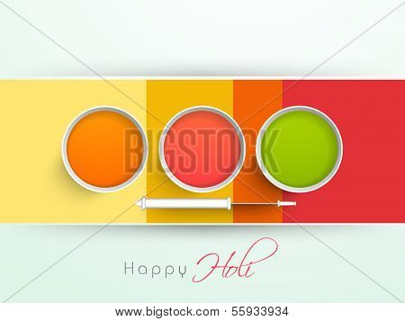 Indian color festival Holi background with buckets with full of colours and pichkari (colour gun) on stripes background.