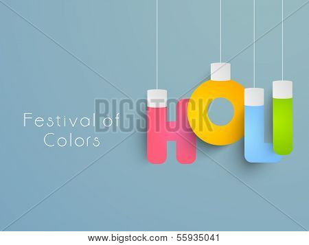 Indian color festival Holi celebration concept with colorful hanging text Holi on blue  background.