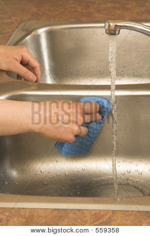 Washing The Sink