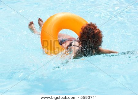 Woman Relaxing In The Hotel Pool