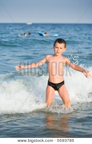 Boy Playing In Sea Water