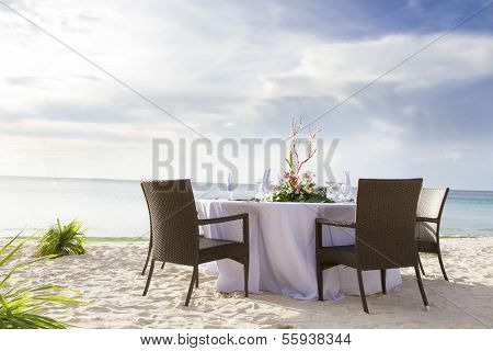 romantic table setup on tropical beach