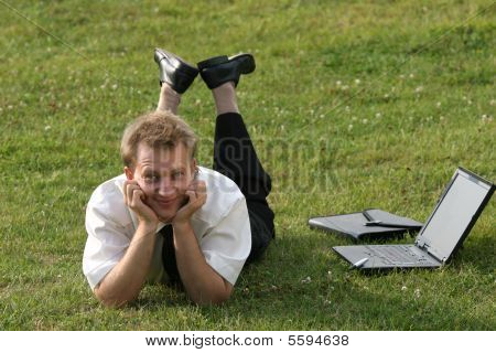 Businessman On The Grass