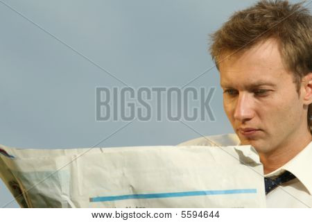 Man Reading A Blank Newspaper