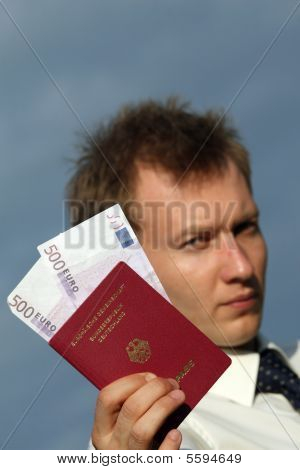 Man Holding German Pass With Money