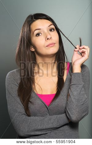 Thoughtful Young Woman Twirling Her Hair