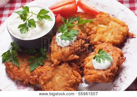 Latke, potato pancakes with sour cream and parsley