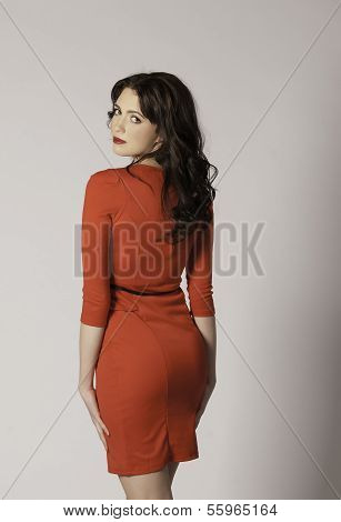 Sexy brunette woman in red dress