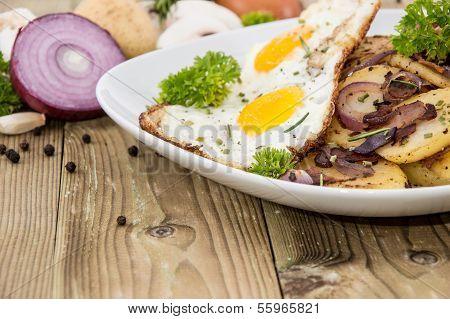 Fried Egg On A Heap Of Roasted Potatoes