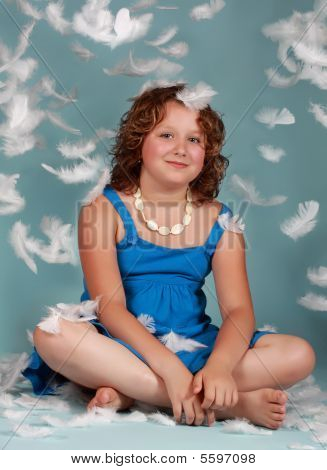 Preteen Girl With White Feathers