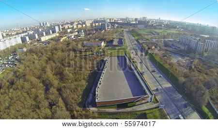 Cityscape at sunny day. View from unmanned quadrocopter