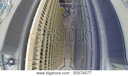 Walls of tall office buildings with many windows. View from unmanned quadrocopter