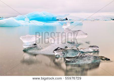 Melting glacier ice at Jokulsarlon lake Iceberg landscape Iceland at Joulsarlon glacier lagoon drifting pack ice melting caused by global warming beautiful arctic travel and tourism location cold