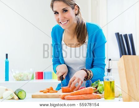 Pretty Young Woman Cooking At Home