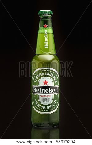 SARAJEVO, BOSNIA and HERZEGOVINA - DEC 23, 2013:  Single Bottle of Heineken Premium Lager Beer.Heineken is a premium brand lager beer brewed in Holland by the Heineken Brewing Company.