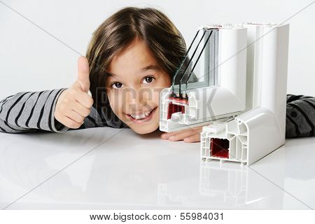 Kid holding plastic pvc window profile