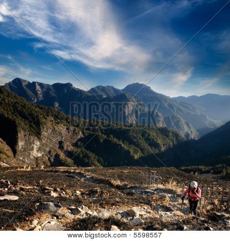 Woman Climbing On The Mountain