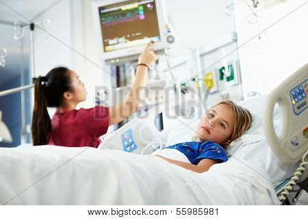 Young Girl With Female Nurse In Intensive Care Unit