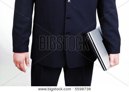 A Young Attractive Male In Suit With Laptop