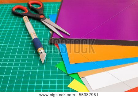 Cutting mat with paper and tools