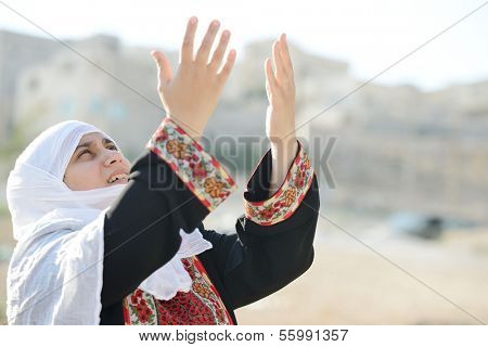 Desperate Arabic woman praying