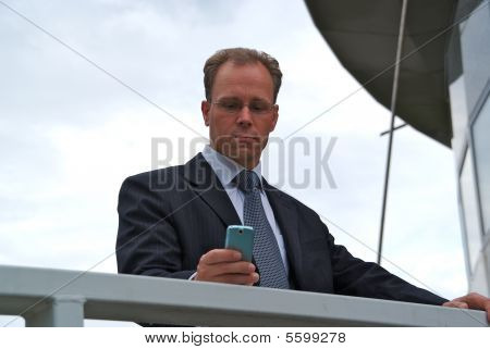Businessman Texting Message With Phone