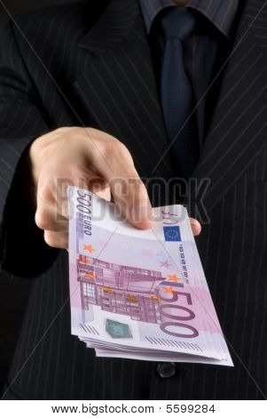 Businessman Holding Euros