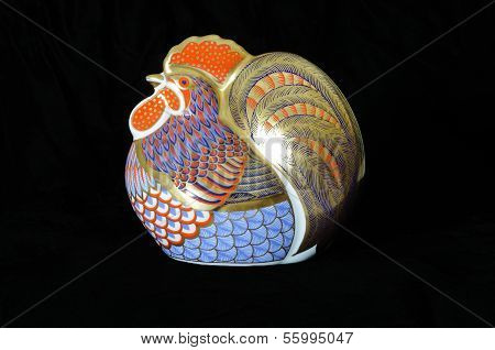 Painted cockerel paperweight.