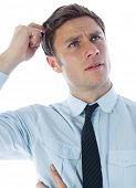stock photo of scratching head  - Thinking businessman scratching head on white background - JPG