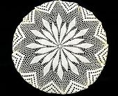 stock photo of doilies  - Vintage hand made embroidered doily on black background - JPG