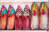 foto of flea  - Colorful ethnic shoes at Anjuna flea market in Goa India - JPG