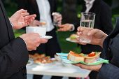 stock photo of buffet lunch  - Business people at the meeting at the lunch buffet - JPG