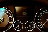 pic of gage  - Color detail with the gauges on the dashboard of a car - JPG