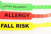 stock photo of allergy  - Latex Allergy Allergy And Fall Risk Patent Bracelets isolated on white - JPG