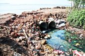 stock photo of toxic substance  - Toxic plastic sewer flowing into the sea - JPG