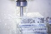 foto of water-mill  - A Industrial milling machine with cooling water - JPG