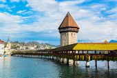 stock photo of chapels  - Panoramic view of wooden Chapel bridge and old town of Lucerne, Switzerland