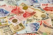 stock photo of ringgit  - A pile of Mixed foreign currency from Asia and the Americas - JPG
