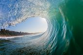 foto of hollow  - Hollow swimming surfing perspective view inside hollow wave tube surging crashing wave towards beach reef shallows - JPG