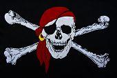 foto of buccaneer  - Jolly Roger sign on black textiles background - JPG