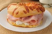 foto of bagel  - A ham sandwich with cream cheese on an onion bagel - JPG