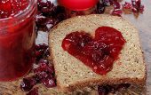 stock photo of jar jelly  - Homemade Organic Jelly on Whole Grain Bread for Valentine - JPG