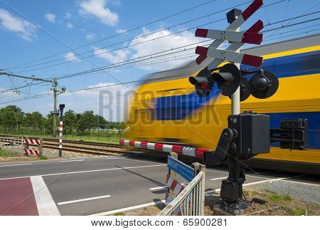 Train riding over a rail crossing