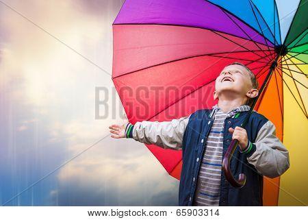 Happy Boy Portrait With Bright Rainbow Umbrella