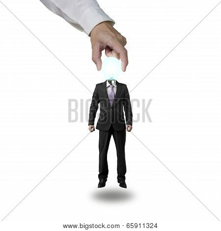 Hand Picking Up Glowing Lamp Head Businessman