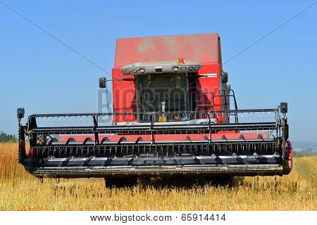 CHLUMCANY, CZECH REPUBLIC - AUG 2, 2013 Combine harvester on a wheat field.
